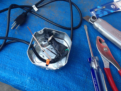 Step 2: Cut and strip one end of the power cable, pass it through a hole in the junction box and secure it inside with a zip tie.  Route the hot wire (Black) through the fuse.