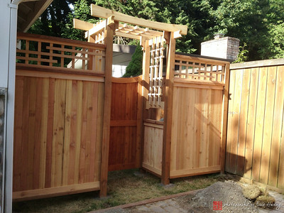 Cedar fence, arbor and gate before stain