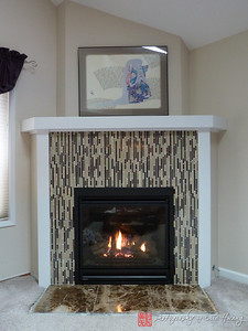 Finished mosaic tile fireplace surround