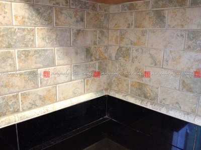 Granite tile countertop and tiled backsplash