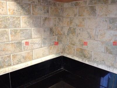 Granite tile countertop and tiled backsplash