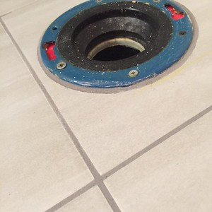 Hand cut circular hole for toilet flange