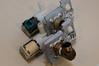 Original valve (with spade connectors) foreground - new valve with specialized connector background.