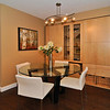 Dining room with wall storage unit.
