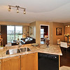 Open concept kitchen with upgraded granite countertop, undermount sink, and Whirlpool Gold appliances.