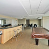 Common meeting or party room on 9th floor with full windows and large balcony looking north.