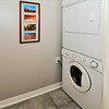 In-suite laundry with upgraded High Efficiency stacked washer and dryer.