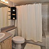 4pc master bathroom with upgraded fixtures and curved shower rod.