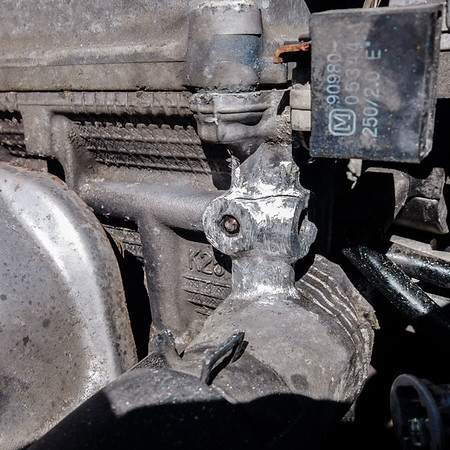 Cleaning and preparing the engine block for repair by scraping aluminium down to a rough shine (Dremel tool.)