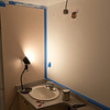 Time to update the master bath to something more presentable. Not a major reno but adding a code of paint, and updated fixtures, faucet, and some extra storage. Here the final patches to the wall after removing the crappy builder light fixture.