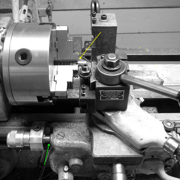 Setting the stop.<br /> The yellow arrow shows that the cutting tool is lined up with one of the marks that we made on the stock.  The green arrow shows that the carriage is up against the stop block.  This will prevent the carriage from moving too far.