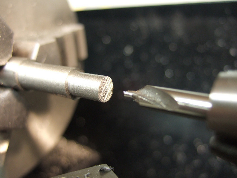 Drilling the insert to remove some material and save a little weight.  It also makes the brazing a little easier (less metal to heat up).