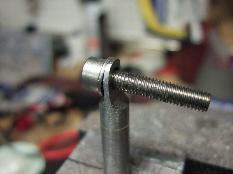 A bolt fits.  There isn't much meat though, and the eyelet bent pretty easily.  So I cut off the head.