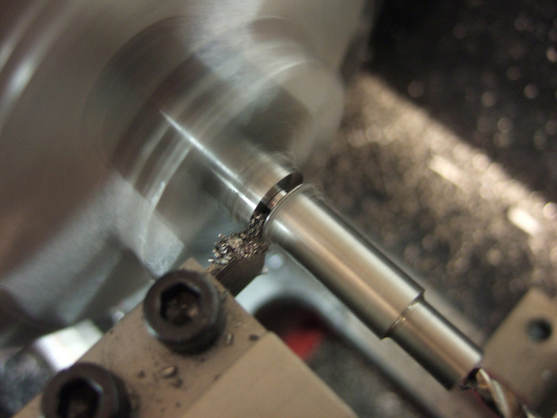 Parting the blank off on the lathe.