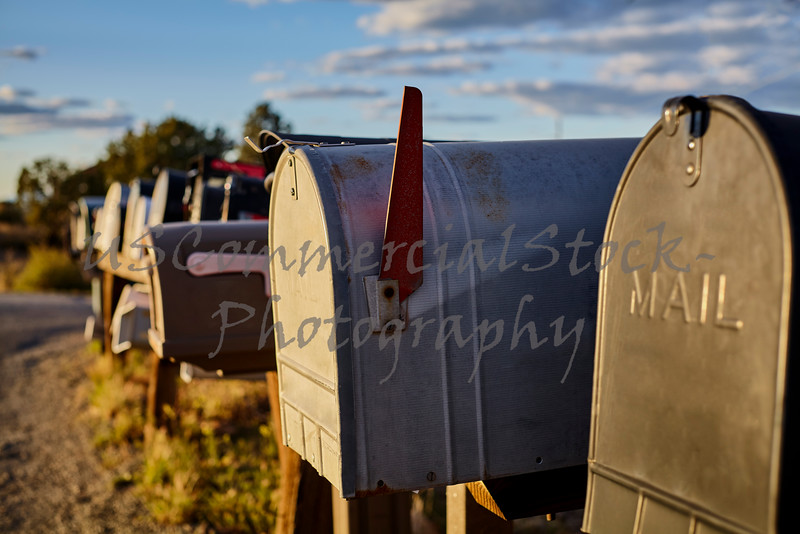 Rural Mailboxes with US Flag in Distance