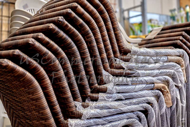 Stack of New Wicker Patio Chairs