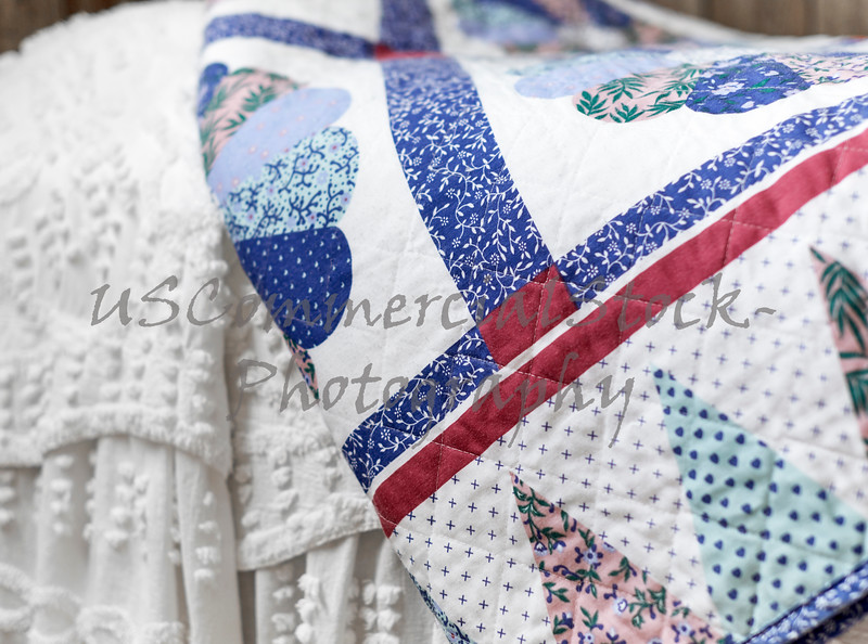Quilt on top of Bedspread