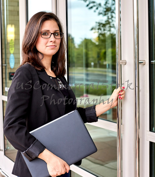 Woman entering Office Building