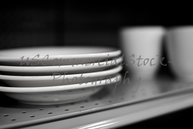 Four White Ceramic Dinner Plates on Shelf