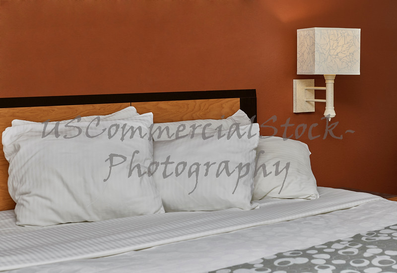 White Down Pillows on a Bed