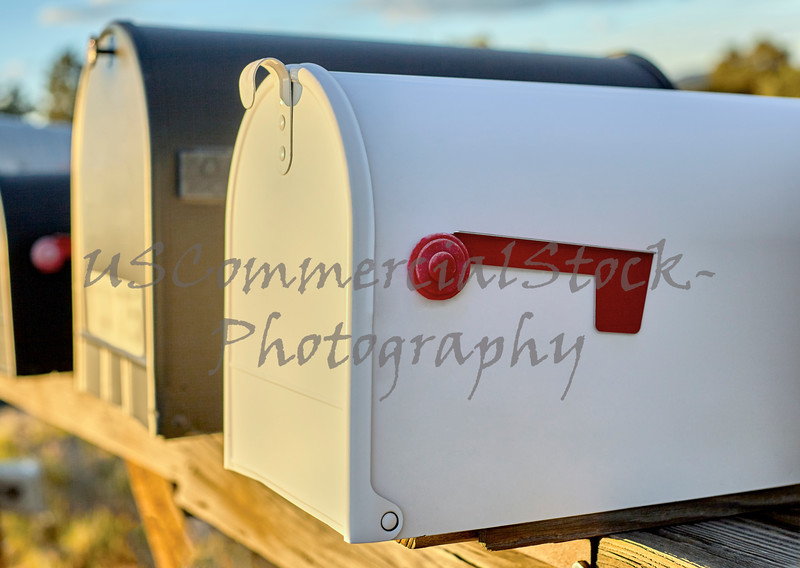 White Mailbox with Red Flag Down
