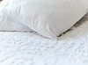 White pillows and Bedspread