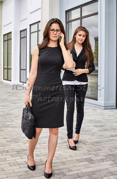 Business Women walking on Sidewalk