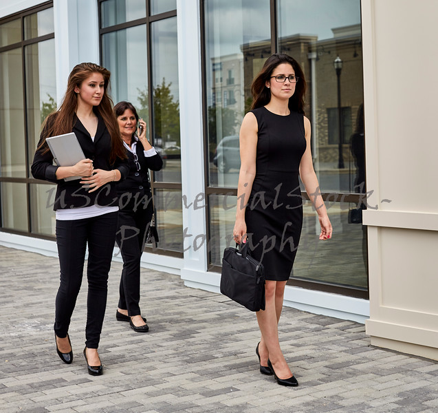 Career Women walking on Sidewalk