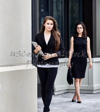 Young Woman exiting Office Building