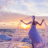 bride on a tropical beach at sunset