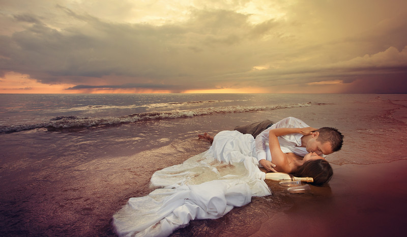 Wedding Romance - bride and groom on the beach