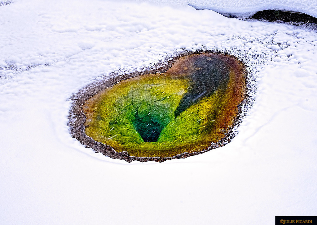 The brilliant colors of this heart-shaped paint pot are exaggerated by the pristine, white snow surrounding it.