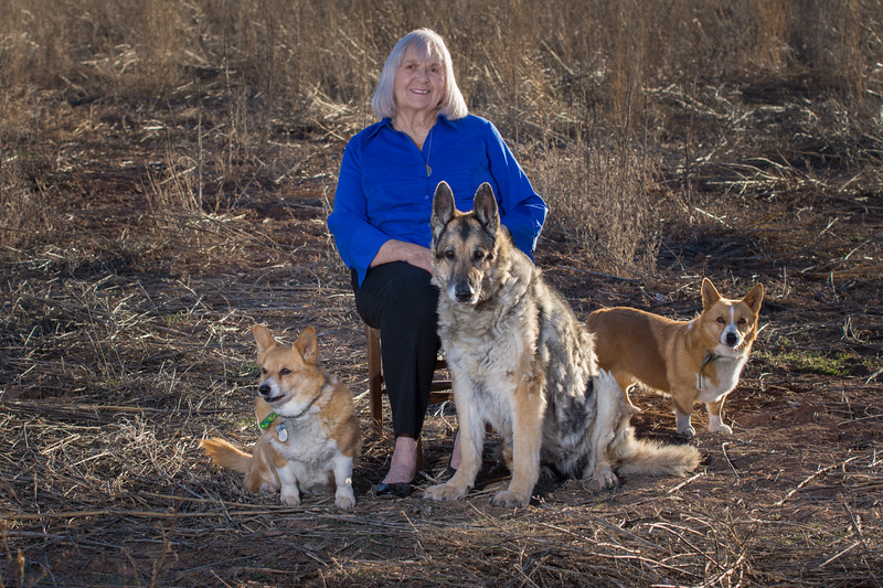 Carolyn and her dogs, Sam, Angie and Corgi