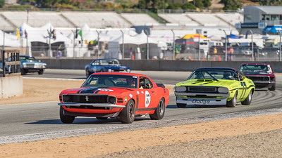 Forrest Straight's Boss 302 leads Richard Goldsmith's Challenger out of Turn 4