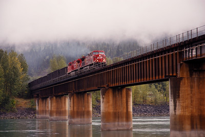 Westbound unit coal train crosses the Coumbia River in Revelstoke, BC, Canada. July 2007