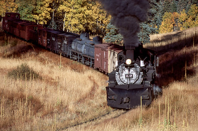 #497 heads uphill on Cumbres & Toltec  Scenic Railroad beyond Labato Bridge.       2005   sce