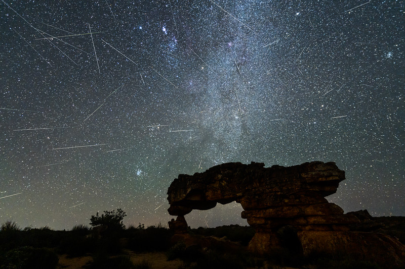 Geminid meteor shower at The Sewing Machine arch, Cederberg, South Africa