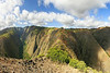 Panoramic view of Koloiki Ridge on the Island of Lana'i, Hawaii.    From this perspective... Maunalei Gulch is on the left side of the ridge (which splits the middle of the frame) and Naio Gulch is on the right.