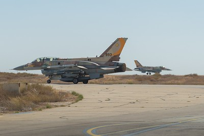 F16 heads towards the runway as another lands in the background- Southern Israel