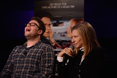 (L-R) Actor Seth Rogen laughs during a press conference with Barbra Streisand in Los Angeles, CA 2012
