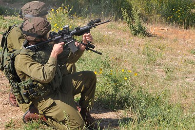"IDF Soldier from the elite ""Duvedevan"" Unit shoots out a window prior to other soldeirs  repelling into it, Israel 2012"