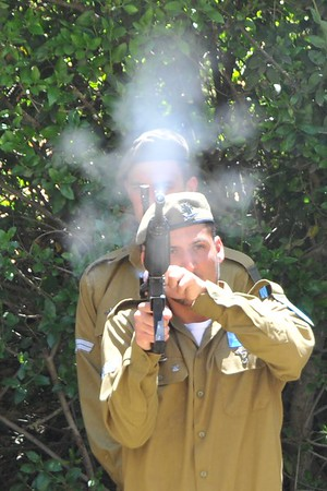 IDF Soldier fires his rifle on Yom HaZikaron, Israel's Memorial Day at a ceremony in Jerusalem, May 2012