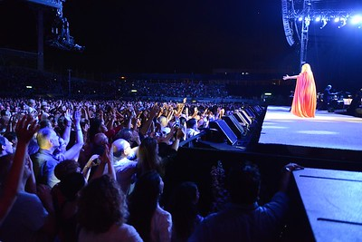 Barbra Streisand performs an encore to her sold out concert as her adoring fans rush the stage. Tel Aviv, Israel- July 2013