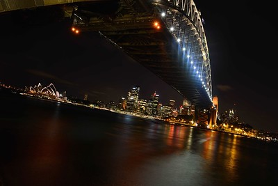 Sydney, Australia at night as seen from under the Sydney Harbor Bridge.