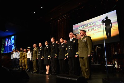 United States Army, Navy and Marine Corps. Officers stand at attention alongside Israel Defense Forces officers during the National Anthem at the Friends of the IDF Los Angeles Gala in 2012