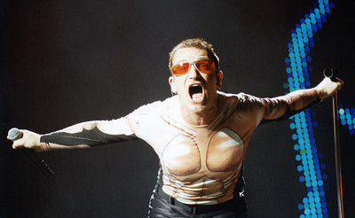 Photograph of Bono, U2 in concert.