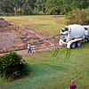 Week 2<br /> 10/6/09 - Tuesday<br /> <br /> The cement truck arrives very early. The first things poured in the footer trenches are dams near the places where the trench steps down. By the time the long sections are poured, the dams have set up .