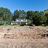 10/1/09 - Thursday<br /> <br /> Chris at front corner of the house. The front porch, first floor will be 9 inches above the horizontal batter board.<br /> <br /> The golden rain tree on the right is in full bloom.