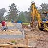 10/13/09 - Tuesday<br /> <br /> Phil has just delivered the heavy tamping machine to the back porch. It was attached to the bucket of the loader on a chain, and swung in to the center of the porch to his son who will use it to compact the sand