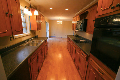 Custom cabinets with new appliances, new can lighting and spacious working areas
